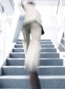 Businessman Running Up Stairs