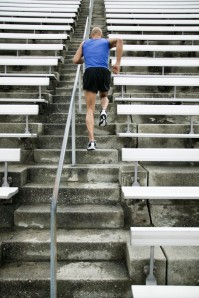 Back View of Man Running on Stairs